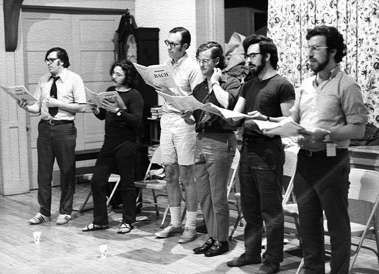 Six of the early Cantata Singers rehearse a Bach piece